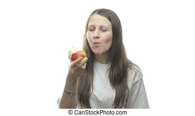 Brunette woman eating apple, fourth video