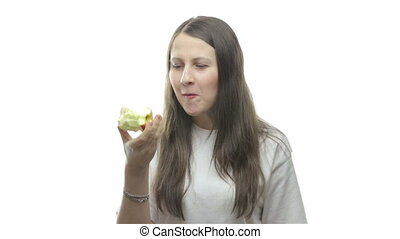 Brunette woman eating apple, ninth video