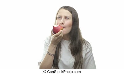 Brunette woman eating apple, second video