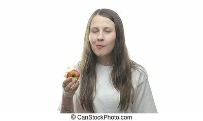 Brunette woman eating apple, seventh video