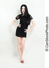 Brunette Woman Fashion Model wearing Black Dress