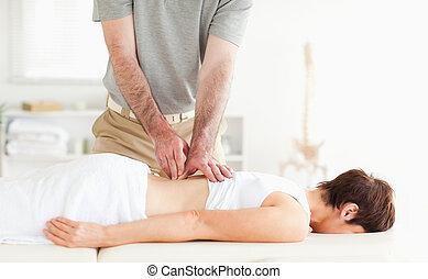 Brunette woman getting a back-massage