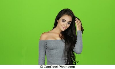 Brunette woman giving out air kisses, emotions. Green screen background