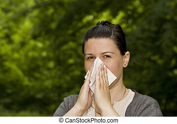 allergy - brunette woman having a pollen allergy in the...