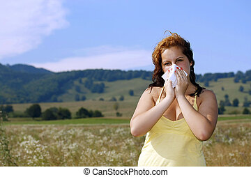 brunette woman having a pollen allergy in the nature