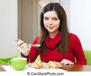 Brunette woman having lunch