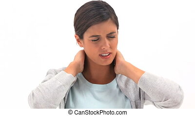 Brunette woman holding her painful neck