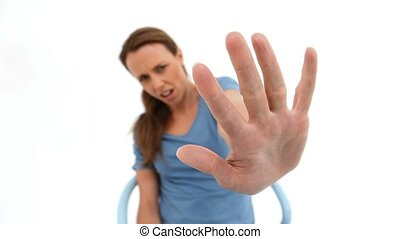 Brunette woman holding her palm out