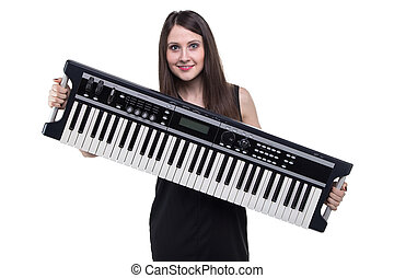 Brunette woman holding synthesizer
