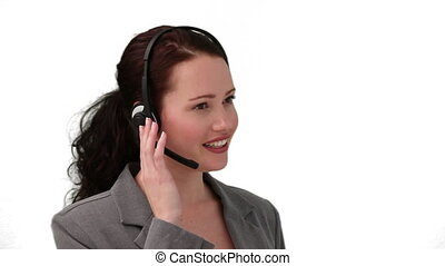 Brunette woman in a call center talking on the phone