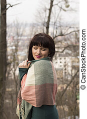 Brunette woman in a scarf outdoor