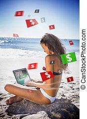 Brunette woman in bikini gambling online