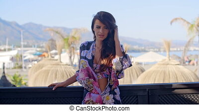 Brunette Woman in Bikini on Beach Resort Balcony