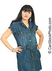Brunette woman in denim dress