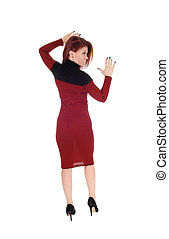 Brunette woman in dress from back.