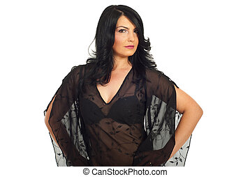 Brunette woman in elegant black blouse