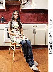 Brunette woman in kitchen