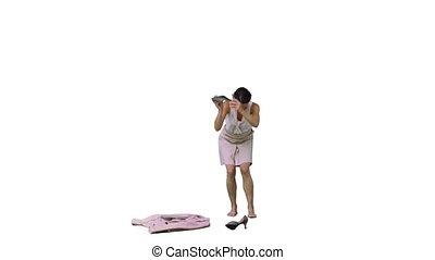 Brunette woman in slow motion throwing her shoe