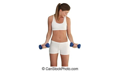 Brunette woman in sportswear with dumbbells