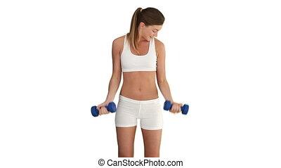 Brunette woman in sportswear with dumbbells