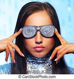 Brunette woman in stylish sunglasses