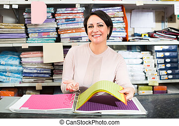 Brunette woman in textile shop. - Positive female customer ...
