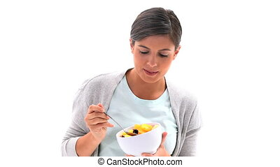 Brunette woman is eating