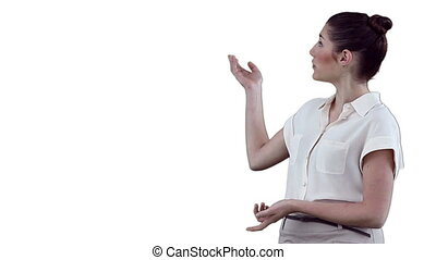 Brunette woman making a presentation using a virtual display