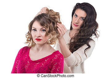Brunette woman making hairstyle