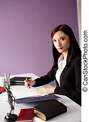 Notary Public notarizes the power of attorney - Brunette...