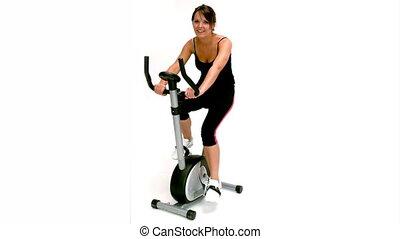 Brunette woman on exercise bike