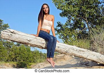 brunette woman on log