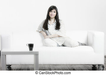 Brunette woman on sofa