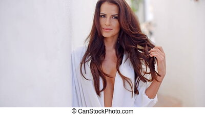 Brunette Woman Outdoors with Hand on Chest