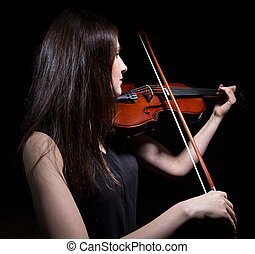 Brunette woman playing on violin from back