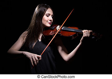 Brunette woman playing on violin