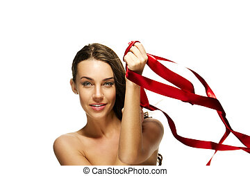 brunette woman playing with a red ribbon on white background