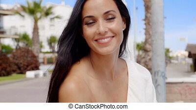 Brunette Woman Posing on Beach Front Promenade