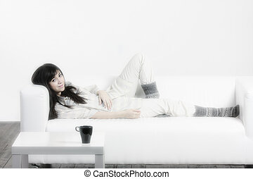 Brunette woman relaxed on sofa