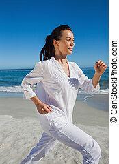 Brunette woman running