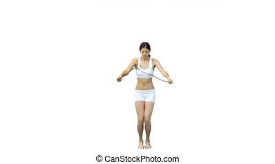 Brunette woman skipping in slow motion