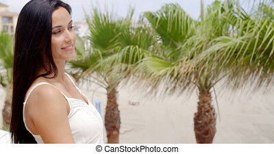 Brunette Woman Smiling at Camera on Tropical Beach