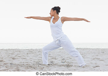 Brunette woman stretching in yoga pose