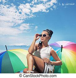 Brunette woman taking the sunbath