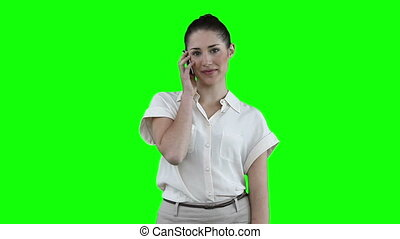 Brunette woman talking on a phone