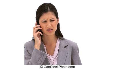 Brunette woman talking on her mobile phone