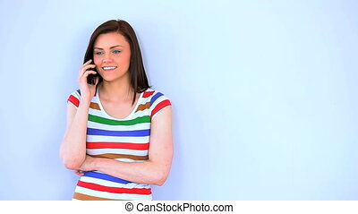 Brunette woman talking on the phone