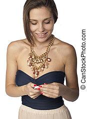 Brunette woman text messaging