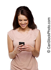 Brunette woman texting on a mobile phone