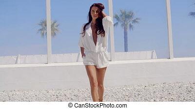 Brunette Woman Walking on Tropical Beach